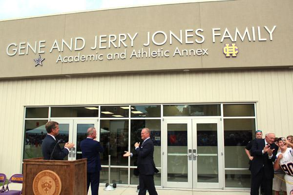 While other dignitaries mingle, Jerry Jones (far right) shares a selfie with students immediately after unveiling the new academic/athletic annex at Catholic High School. (Dwain Hebda photo)