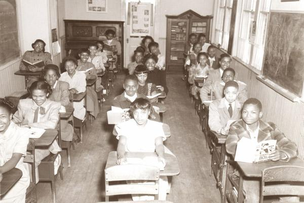 Students at St. Bartholomew School in Little Rock smile from their desks in this 1949 photo. The school was about a half-mile away from Central High School in Little Rock. (Diocese of Little Rock archives)