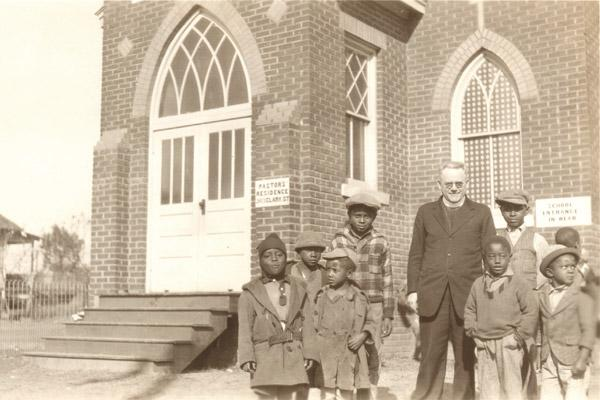 Father Joseph Haarman, SVD, stands with the first pupils of St. Augustine School in North Little Rock in September 1929. In the late 1950s, the Illinois-based Sisters of Christian Charity taught at the school. (Diocese of Little Rock archives)