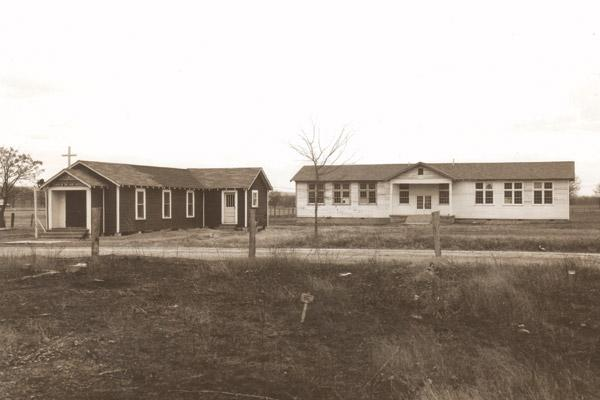 A 1949 photo shows the black Good Shepherd Church and School in Conway. The school was built from surplus Army barracks transported from Fort Smith. (Diocese of Little Rock archives)
