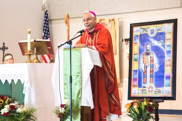 Bishop Anthony B. Taylor delivers his homily at Blessed Stanley Rother Mission during a Sept. 24 Mass at the local elementary school. (Travis McAfee photo)