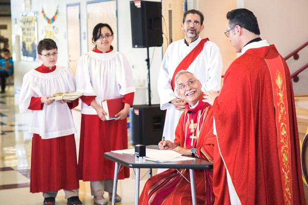 Bishop Taylor smiles at pastor Father Salvador Marquez-Munoz as he officially dedicates the Decatur community. (Travis McAfee photo)