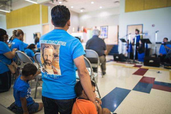 Many parishioners wore blue Blessed Father Stanley Rother T-shirts during the dedication Mass.  (Travis McAfee photo)