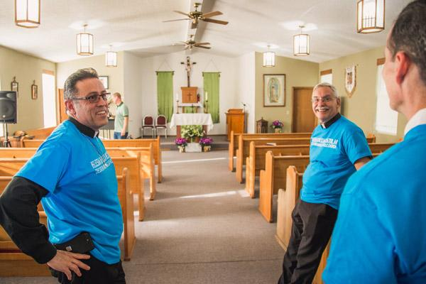 Father Marquez-Munoz, Bishop Taylor and Dr. Muldoon of Extension Society tour Blessed Stanley Rother Mission following the Mass and dinner. The former Baptist church was too small to host the Sept. 24 Mass. (Travis McAfee photo)