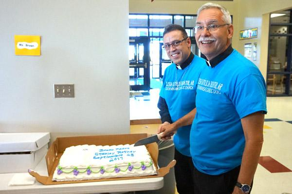 Bishop Taylor and Father Marquez-Munoz celebrate the dedication of the Blessed Stanley Rother Mission with a special cake. (Aprille Hanson photo)