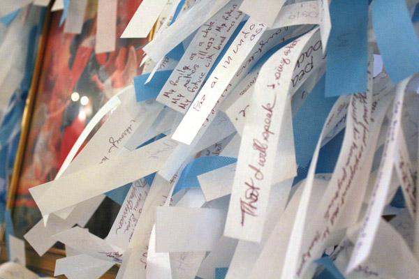 Prayer intentions written on ribbons crowd the prayer frames as part of the Mary Undoer of Knots Prayer Project. (Dwain Hebda photo)