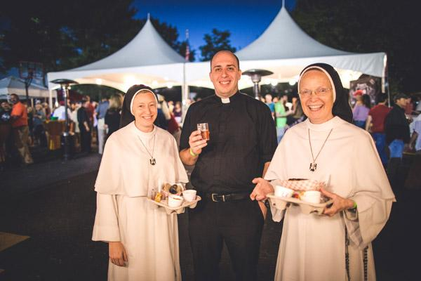 Sister Maria Catherine and Sister Joseph Andrew, OP, Mother of the Eucharist of Michigan, stop by Brewtober on their visit to the area. Newly ordained Father William Burmester enjoys their company. (Travis McAfee photo)