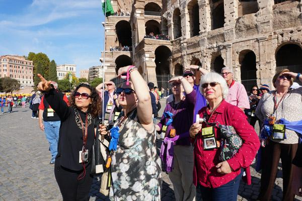 A Roman tour guide points to other arches still standing around the Flavian Amphitheater, better known as the Colosseum, Nov. 2. Listening are Robyn Bradley of North Little Rock, Alice Nahas of Paris, Rena Harrison of Pine Bluff and Barbara Menz Bryan of Texas. (Malea Hargett photo)