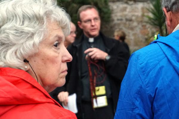 Debbie Vaughn of Lake Village listens to Father Erik Pohlmeier prepare pilgrims Nov. 3 before an afternoon retreat of mediation, prayer and confession at Tre Fontane (Three Fountains) Abbey, site of where St. Paul was beheaded in Rome. (Malea Hargett photo)