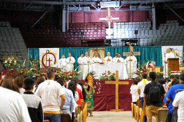 Eight priests concelebrated Mass with Bishop Taylor in Barton Coliseum. (Malea Hargett photo)
