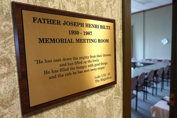A meeting room named for Father Joe Biltz is on the fourth floor of Morris Hall at St. John Center. In it hangs memories of Father Biltz, including the posthumous 1988 Civil Libertarian of the Year Award from the ACLU of Arkansas. (Aprille Hanson photo)