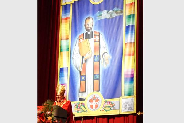 At the Sept. 23 beatification of Father Stanley Rother in Oklahoma City, Cardinal Angelo Amato, S.D.B, Prefect of the Congregation for the Causes of Saints, read a formal letter from the Vatican. A banner for Blessed Stanley was unveiled with the archdiocesan coat of arms. (Malea Hargett photo)