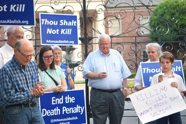 Members of the Arkansas Coalition to Abolish the Death Penalty, Catholic peace group Pax Christi of Little Rock and other opponents of the death penalty sing and pray in front of the Governor's Mansion April 24. (Malea Hargett photo)