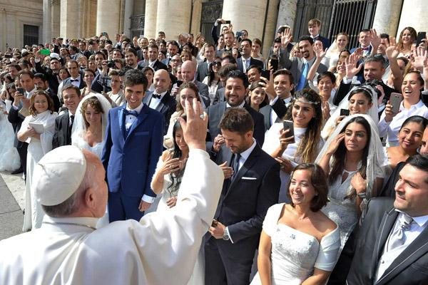 "Pope Francis greets newly married couples during his general audience in St. Peter's Square at the Vatican in this Sept. 30, 2015, file photo. In 2016 the pope released a major document, ""Amoris Laetitia,"" which focused on love in the family. (CNS photo/L'Osservatore Romano)"