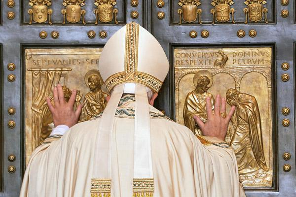 Pope Francis opens the Holy Door of St. Peter's Basilica to inaugurate the Jubilee Year of Mercy at the Vatican in this Dec. 8, 2015, file photo. The pope surprised the world with his March 13, 2015, announcement of a special holy year. (CNS photo/Maurizio Brambatti, EPA)