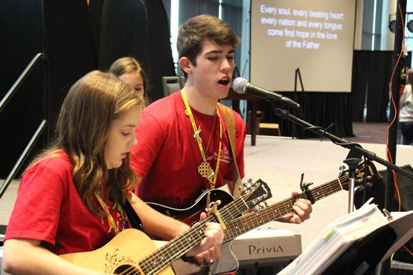 Chandler Vail and Cecelia Rech, both of Christ the King Church in Little Rock, lead praise and worship music during the 2018 Catholic Youth Convention. (Dwain Hebda photo)