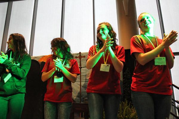 Convention-goers liven up a morning session leading the crowd in a dance routine. They are (from left) Kathy Rogel of Hope, Anabel Galvan of Russellville and Daisy Woodbury and Cassie Farmer of Mountain Home. (Dwain Hebda photo)