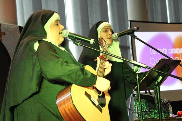 Nun and Nunner, aka Sister Mary Rose (left) and Sister Maria Stella provide lively music and humor with a message for teens from across Arkansas at the 2018 Catholic Youth Convention in Little Rock. (Dwain Hebda photo)