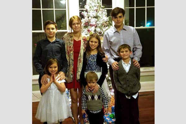 The seven younger Caruthers children of Fort Smith stand for their annual Christmas portrait. They are (back row from left), Jack, 14; Amelia, 19; Ellie, 11; and Joseph, 17. Front row from left are Bridget, 6; Ben, 3; and Eli, 9. Not pictured is Annalie, 21.