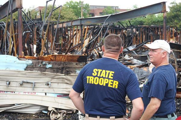 Arkansas State Police Sgt. Mike Dawson (right) discusses the fire that destroyed the Arkansas Pregnancy Resource Center in Little Rock with ASP Cpl. Josh Berry on May 21. (Aprille Hanson photo)