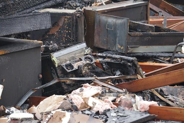 A charred ultrasound machine donated in 2014 by the Knights of Columbus sits among debris from the May 20 Arkansas Pregnancy Resource Center fire. (Aprille Hanson photo)