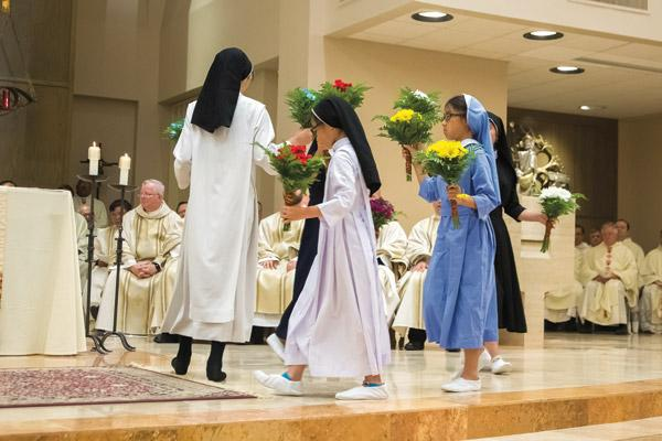 The Vietnamese Eucharistic Youth from Barling perform a traditional dance in honor of Mary. (Bob Ocken)