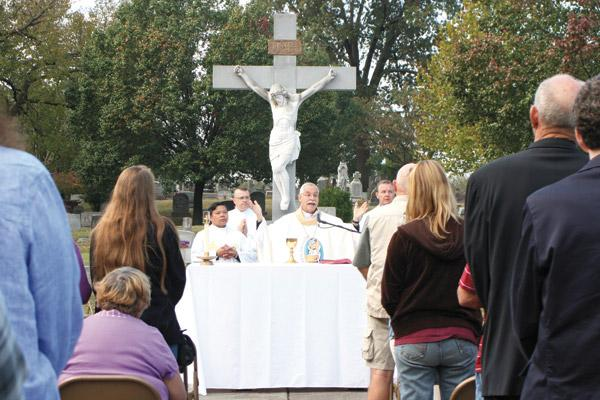 Bishop Taylor concelebrates the annual All Souls Day Mass at Calvary Cemetery Nov. 2, 2016 with about 50 of the faithful. (Aprille Hanson / Arkansas Catholic file)