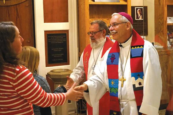 Bishop Anthony B. Taylor (right) and Bishop Michael Girlinghouse of the Arkansas-Oklahoma Synod of the Evangelical Lutheran Church in America (ELCA) shake hands with people after the Oct. 30 prayer service at the Cathedral of St. Andrew in Little Rock commemorating the 500th anniversary of the Protestant Reformation. (Aprille Hanson / Arkansas Catholic file)