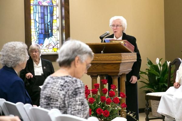 Sister Maria DeAngeli addresses the congregation after Communion at the dedication Mass of St. Scholastica Monastery Chapel. (Karen Schwartz photo)
