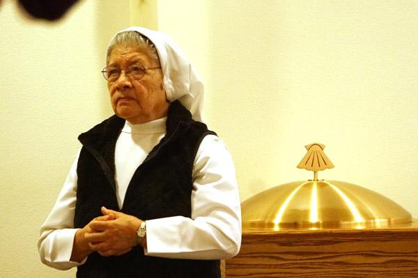 Sister Adela Lopez, a Missionary Carmelite of St. Teresa, prepares to distribute Communion. (Malea Hargett photo)