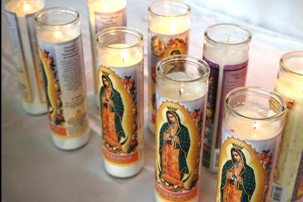 Vigil candles for Our Lady of Guadalupe burn during the fiesta. (Malea Hargett photo)