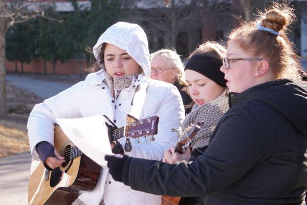 Members of Team Jesus bundle up while leading the participants in a song at the first station of the Eucharistic Procession for Life. (Malea Hargett photo)