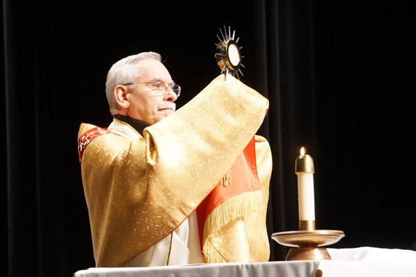 Bishop Taylor elevates the monstrance during the Benediction before the Mass for Life at Robinson Center Performance Hall. (Malea Hargett photo)
