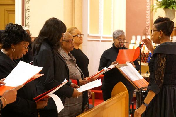 The diocesan choir from St. Augustine Church in North Little Rock, St. Peter Church in Pine Bluff and St. Bartholomew Church in Little Rock lead the congregation in music. (Malea Hargett photo)
