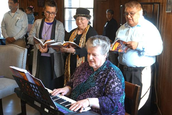 Choir members provide music for the March 16 bilingual Mass that officially established the St. Oscar Romero Catholic Community of Greenbrier. (Aprille Hanson photo)