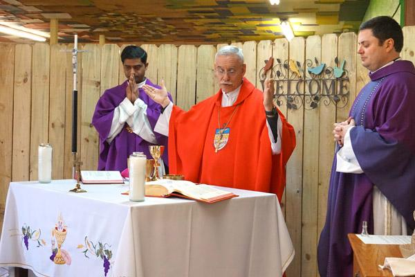 Bishop Taylor celebrates the Liturgy of the Eucharist with Pastor Father Tony Robbins (right) and associate pastor Father Chandra Kodavatikanti at the St. Oscar Romero Catholic Community in Greenbrier March 16. (Aprille Hanson photo)
