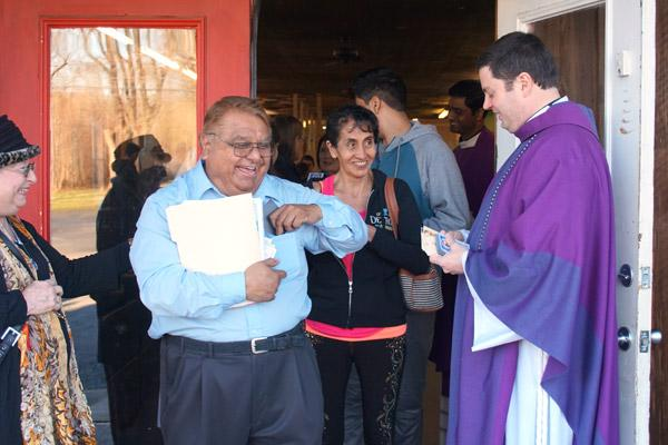 Choir member Bob Salas smiles while leaving Mass in Greenbrier after receiving a St. Oscar Romero magnet from Pastor Father Tony Robbins of St. Joseph Church in Conway. Salas, who lives in Greenbrier, will attend Mass at the St. Oscar Romero Catholic Community. (Aprille Hanson photo)