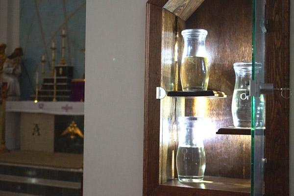 The ambry at St. Patrick Church in North Little Rock, built last year, displays the three types of holy oils kept on hand for sacraments throughout the year: chrism, oil of catechumens and oil of the sick. (Aprille Hanson photo)