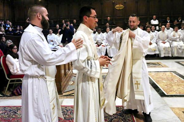 Father Stephen Gadberry (rights), of Batesville, vests his friend and fellow priest Father Amaro along with Father Jeff Hebert of Conway during his ordination in Rome. (Denis Nakkeeran photo, Pontifical North American College)