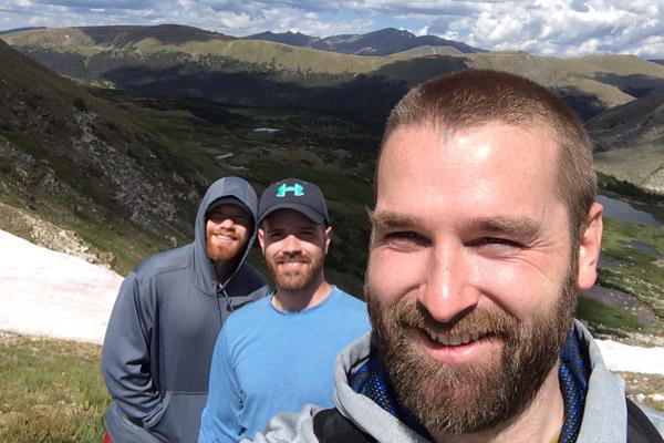Then-seminarians Jeff Hebert, Patrick Friend (center) and Joseph Friend pause for a selfie while hiking Rocky Mountain National Park in July 2017. Even after life changed for Father Hebert and Father Patrick Friend with their 2018 ordination, they still enjoy hiking.