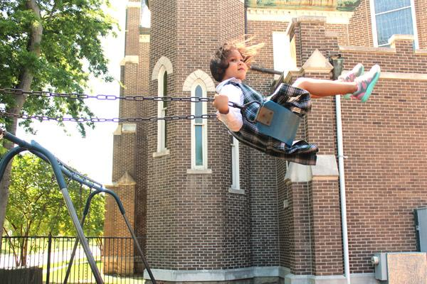 PreK student Nariah Delaney flies as high as the swing will take her during recess. Delaney and her St. Edward classmates and teachers said goodbye to the 134-year-old school May 24. (Dwain Hebda photo)