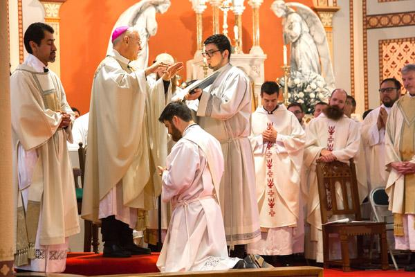 During the prayer of ordination, Bishop Taylor prays over Jon Miskin, which is the essential act of ordination. (Bob Ocken photo)