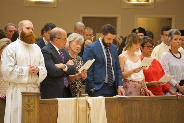 Seminarian Joseph Friend stands with his father Dr. Jerry Friend, stepmother Dona and other family members at the beginning of his diaconate ordination Mass May 22 at Christ the King Church in Little Rock. (Malea Hargett photo)
