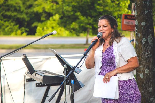 Sheila Pursell, executive director of the Northwest Arkansas Catholic Respect Life Council, opens the July 25 prayer service giving thanks for the closing of Planned Parenthood's Fayetteville clinic. (Travis McAfee photo)