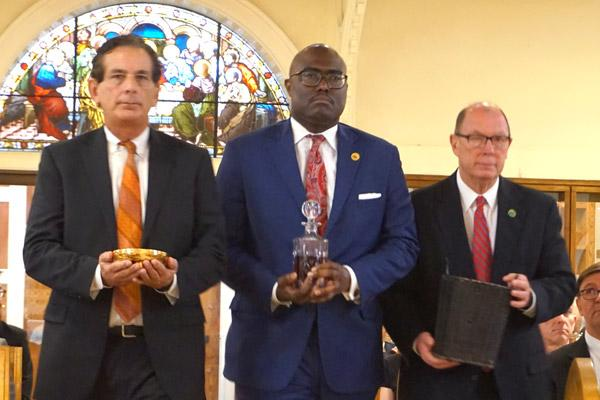 North Little Rock's Chief of Staff Danny Bradley (left), Little Rock Mayor Frank Scott Jr. and Pulaski County Judge Barry Hyde bring the gifts to the altar during the Red Mass on Oct. 4 at the Cathedral of St. Andrew in Little Rock. (Aprille Hanson photo)