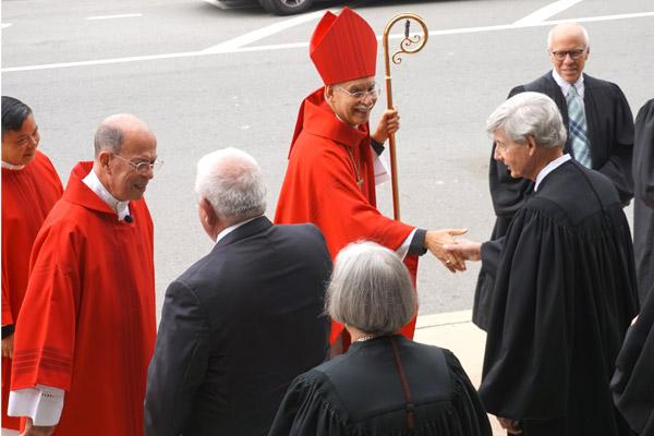 Bishop Taylor greets Pulaski County District Court judge Wayne Gruber and others outside the Cathedral of St. Andrew in Little Rock following the Red Mass on Oct. 4. (Aprille Hanson photo)