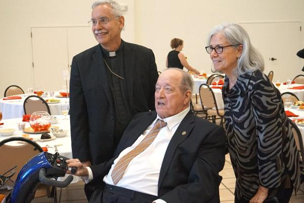 Former judge Charles Baker, a parishioner at Our Lady of the Holy Souls in Little Rock, smiles with Bishop Anthony B. Taylor and former law clerk Lucille DeGostin. Baker received the St. Thomas More Award Oct. 4. (Aprille Hanson photo)