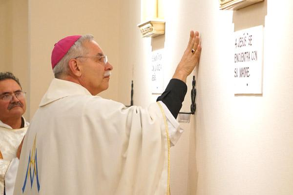 Bishop Anthony B. Taylor anoints the walls of the new St. Luke Church in Warren with sacred chrism during the dedication Mass Nov. 23. (Malea Hargett photo)