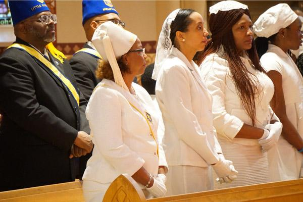 Members of the Knights and Ladies of Peter Claver stand together during the Dr. Martin Luther King Jr. Memorial Mass Jan. 11 at the Cathedral of St. Andrew in Little Rock. (Malea Hargett photo)
