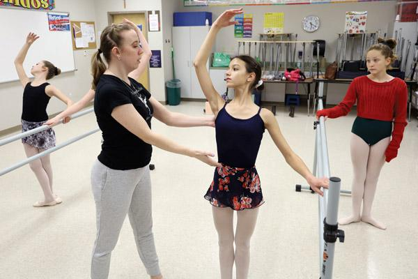 Maria Dumond takes pointers on her form from ballet instructor Rachel Hicks. Dumond, a sixth-grader who has a goal of dancing professionally one day, describes dance as a good source of stress relief. (Dwain Hebda photo)